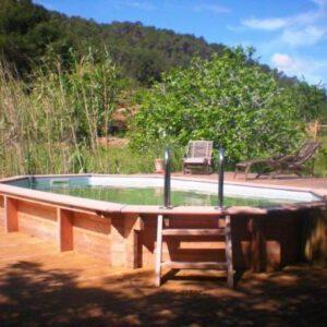 Piscinas de madera maciza 10 a os de garant a piscinas for Piscinas de madera baratas