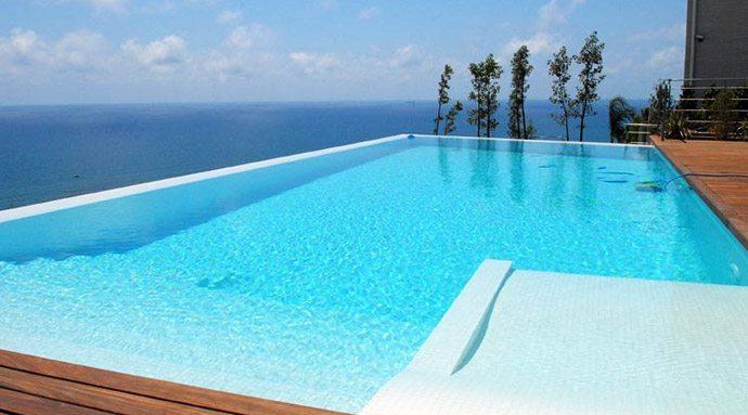 Piscinas de madera piscinas prefabricadas 96 157 03 26 for Casas de madera con piscina